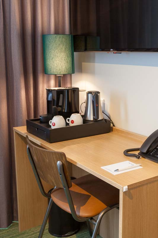 Comfortable hotel room with desk